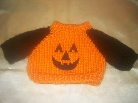 Pumpkin Face Sweater with Black Sleeves