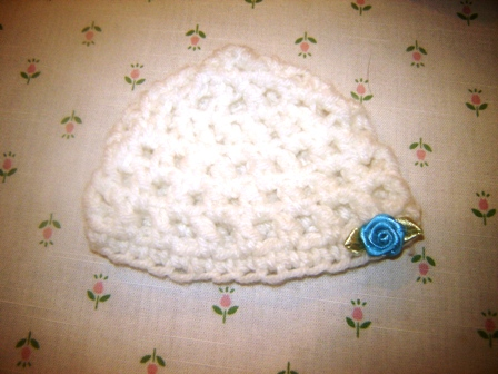 White Crocheted  Hat with Tiny Blue Rosebud